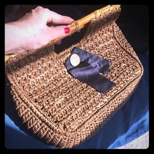 Vintage straw clutch with bamboo handle